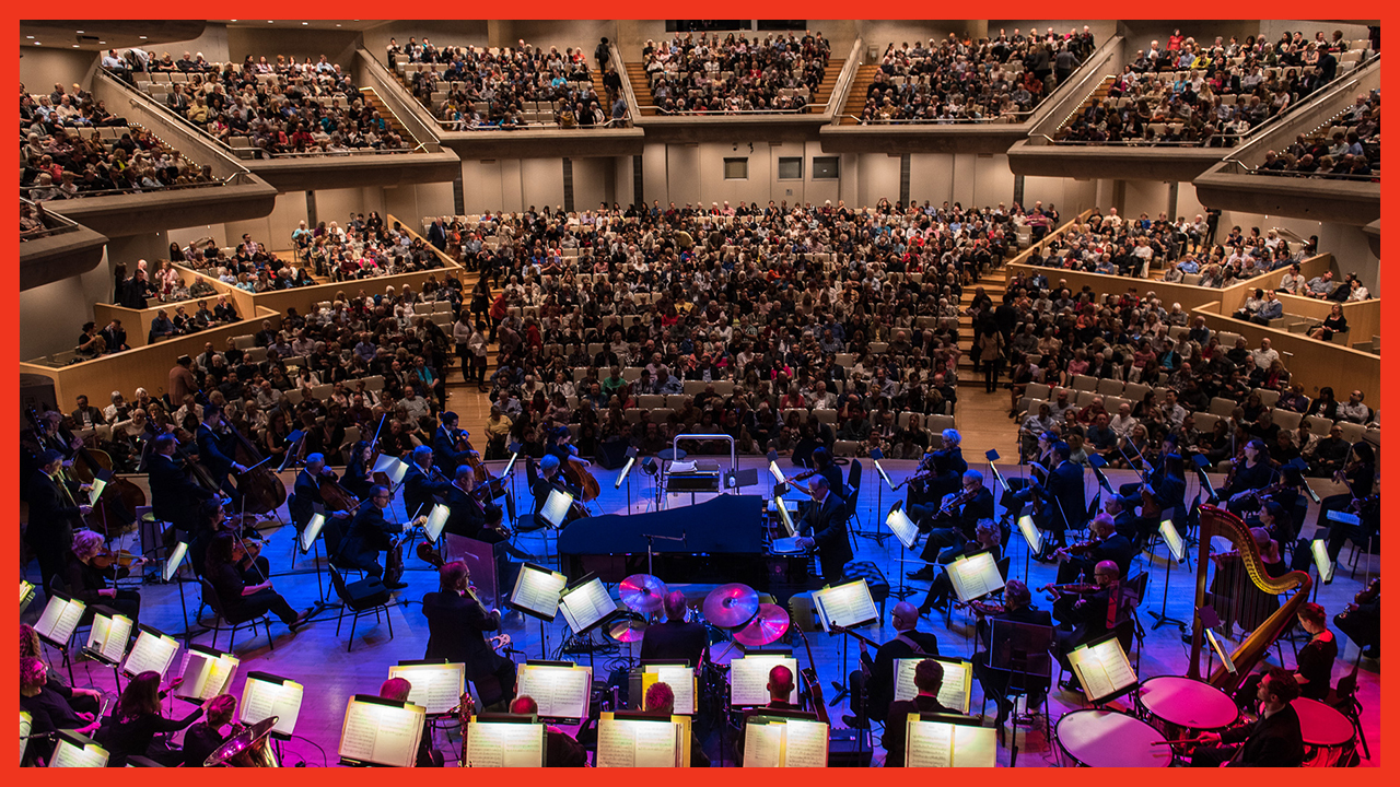 A photo of the Toronto Symphony Orchestra in performance at Roy Thomson Hall